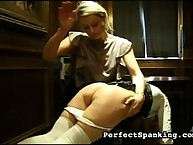 Blond schoolmarm spanking two schoolgirls