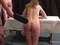 Red haired floozy was paddled