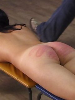 16 of Naked young lovely paddled and caned on her bare ass bent over the exercise bench