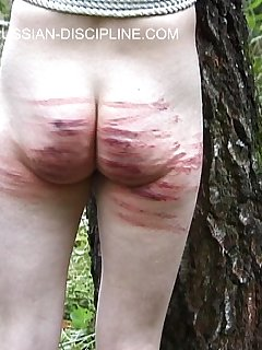 16 of Cute redhead brutally caned on her bared ass