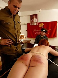 16 of Pigtailed russian redhead bound on the table for a severe caning