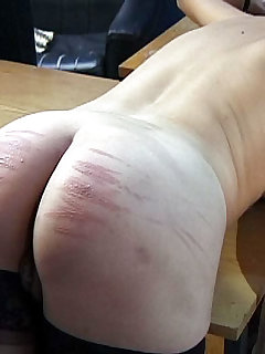 16 of Pretty redhead interrogated, stripped and mercilessly caned across the desk