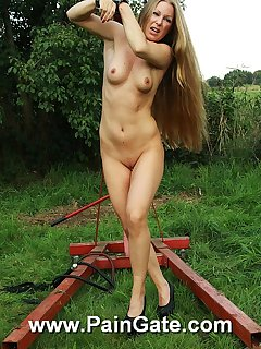 18 of Blonde babe is tortured outdoor