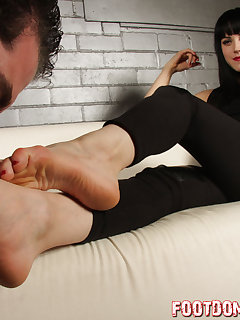 12 of Mistress O enjoys foot worship and toe sucking from slave