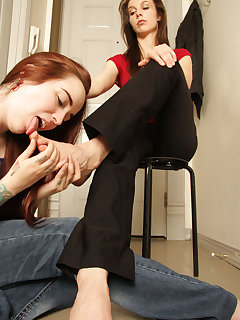 12 of Genetica gets a nice foot rub and licking by slave girl