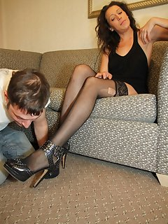 12 of Jacque makes her slave get on his knees and lick on her heels
