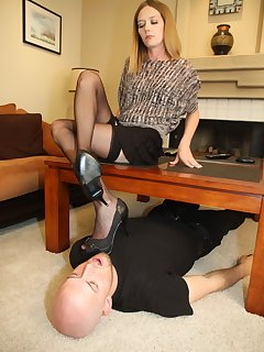 12 of Star teases her slave under her with her dangling stockings feet