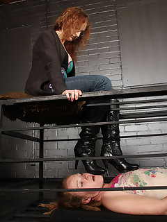 12 of Dominating her caged up slave girl with her boots