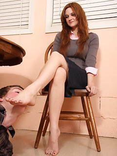 12 of Licking on Jennifer's bare feet under table