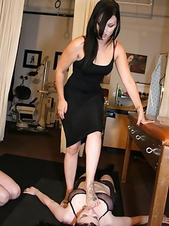 8 of Mistress is trampling slavegirl while another one licking her feet